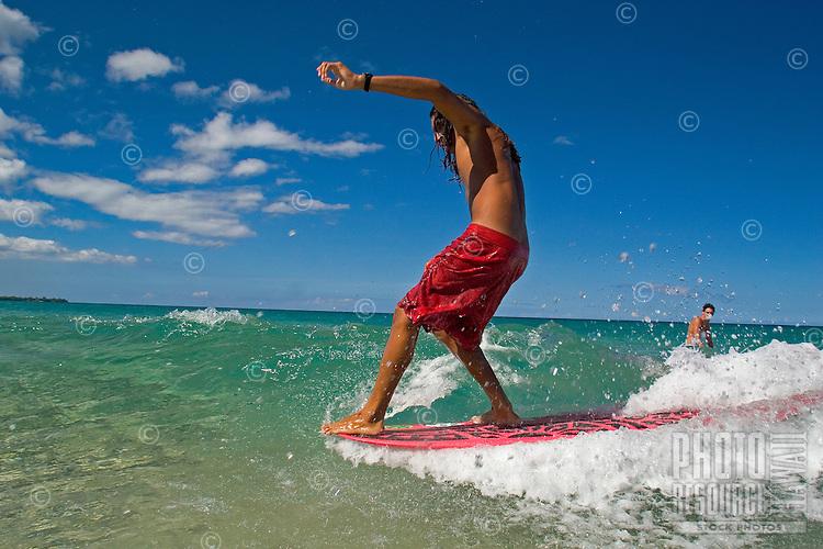 Surfer on wave at Hapuna Beach on the Big Island of Hawaii