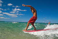 Surfer on wave at Hapuna Beach on the Big Island of Hawaii