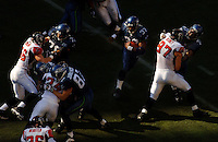 Sep 18, 2005; Seattle, WA, USA; Seattle Seahawks running back Shaun Alexander #37 runs the ball as the Atlanta Falcons defense attempts to break in the fourth quarter at Qwest Field. Mandatory Credit: Photo By Mark J. Rebilas