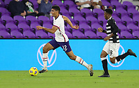 ORLANDO CITY, FL - JANUARY 31: Miles Robinson #12 of the United States dribbles with the ball during a game between Trinidad and Tobago and USMNT at Exploria stadium on January 31, 2021 in Orlando City, Florida.