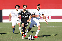 RICHMOND, VA - SEPTEMBER 30: Kenny Hot #76 of New York Red Bulls II plays the ball away from Marios Lomis #9 of North Carolina FC during a game between North Carolina FC and New York Red Bulls II at City Stadium on September 30, 2020 in Richmond, Virginia.