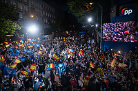 MADRID, SPAIN – MAY 04: Hundreds of people celebrate the victory of the elections in front of the PP headquarters with flags of the PP and Spain on 4 May in Madrid, Spain. . (Photo by Joan Amengual / VIEWpress via Getty Images)