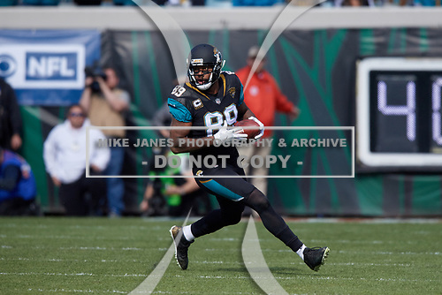 Jacksonville Jaguars tight end Marcedes Lewis (89) runs up field after catching a pass during an NFL Wild-Card football game against the Buffalo Bills, Sunday, January 7, 2018, in Jacksonville, Fla.  (Mike Janes Photography)