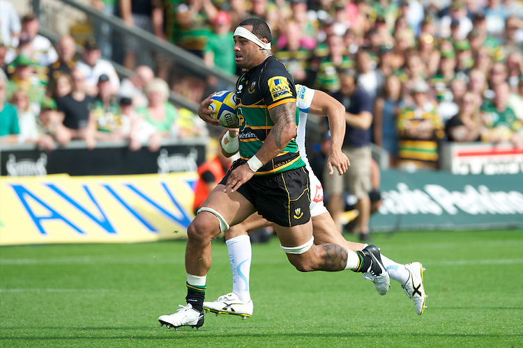 Samu Manoa of Northampton Saints accelerates in midfield during the Aviva Premiership match between Northampton Saints and Exeter Chiefs at Franklin's Gardens on Sunday 9th September 2012 (Photo by Rob Munro)