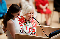 USA International Harp Competition Founder and Artistic Director Susann McDonald, right, and Executive Director Erin Brooker-Miller share a smile during the opening ceremony of the 11th USA International Harp Competition at Indiana University in Bloomington, Indiana on Wednesday, July 3, 2019. (Photo by James Brosher)