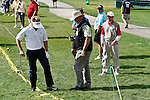 PALM BEACH GARDENS, FL. - Stuart Appleby and a PGA Rules Offical take a drop after Appleby hit out of bounds on hole 18 during Round Two play at the 2009 Honda Classic - PGA National Resort and Spa in Palm Beach Gardens, FL. on March 6, 2009.