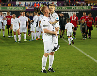 Alan Tate of Swansea Legends kisses his boy during the Swansea Legends v Manchester United Legends at The Liberty Stadium, Swansea, Wales, UK. Wednesday 09 August 2017
