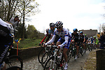 The peloton including Tom Boonen (BEL) Omega Pharma-Quickstep and Edvald Boasson Hagen (NOR) Sky Procycling enter the Molenberg climb during the 96th edition of The Tour of Flanders 2012, running 256.9km from Bruges to Oudenaarde, Belgium. 1st April 2012. <br /> (Photo by Steven Franzoni/NEWSFILE).