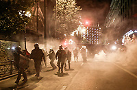 Pictured: Riot police in smoke on the first day of visit by  German Chancellor Angela Merkel in central Athens, Greece.<br /> Re: Official visit of German Chancellor Angela Merkel  to Athens, Greece.