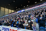 Rangers fans stand and applaud on the 2nd minute for Fernando Ricksen