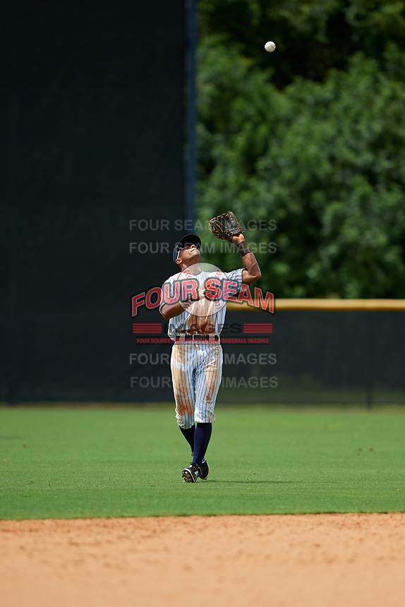 GCL Yankees East shortstop Ricky Surum (20) settles under a fly ball during the second game of a doubleheader against the GCL Blue Jays on July 24, 2017 at the Yankees Minor League Complex in Tampa, Florida.  GCL Yankees East defeated the GCL Blue Jays 7-3.  (Mike Janes/Four Seam Images)