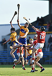 Ian Galvin and Cathal Malone of Clare in action against Eoin Cadogan of Cork during their Munster Hurling League game at Cusack Park. Photograph by John Kelly.