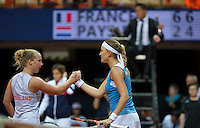 Arena Loire,  Trélazé,  France, 16 April, 2016, Semifinal FedCup, France-Netherlands, Second match: Kristina Mldanovic vs Richel Hogenkamp (NED), Pixtured : Richel Hogenkamp congratulates Mladenovic<br />