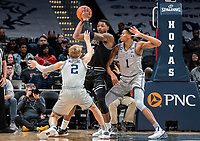 WASHINGTON, DC - FEBRUARY 19: Mac McClung #2 and Jamorko Pickett #1 of Georgetown defend against Emmitt Holt #15 of Providence during a game between Providence and Georgetown at Capital One Arena on February 19, 2020 in Washington, DC.