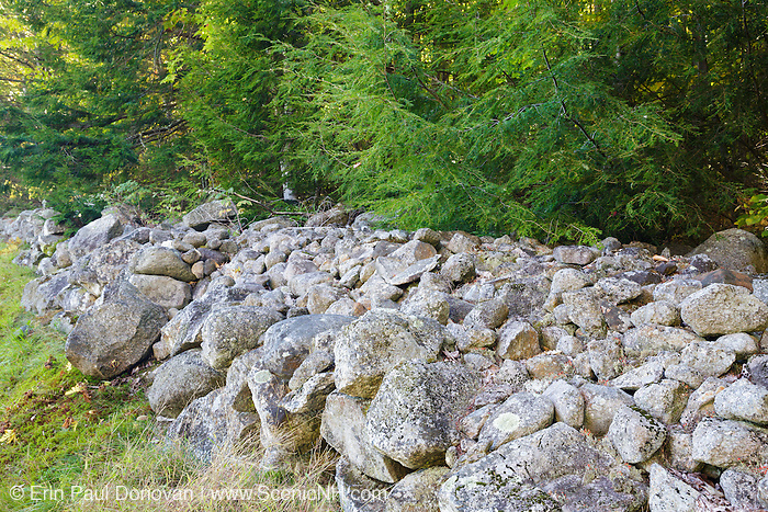 Stone wall at Center Harbor Memorial Park Cemetery in Center Harbor, New Hampshire USA during the autumn months.