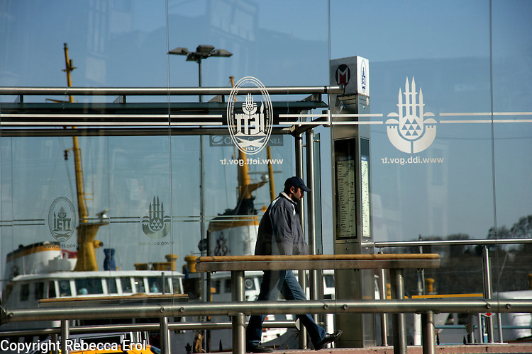Urban scene with tram stop and ferry boat, Istanbul, Turkey