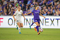 Orlando, FL - Saturday March 24, 2018: Orlando Pride defender Shelina Zadorsky (4) plays the ball back and away from Utah Royals forward Elise Thorsnes (20) during a regular season National Women's Soccer League (NWSL) match between the Orlando Pride and the Utah Royals FC at Orlando City Stadium. The game ended in a 1-1 draw.