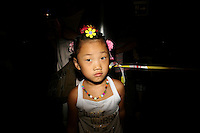 CHINA. Beijing. A young girl near the Olympic village during the Beijing 2008 Summer Olympics. 2008