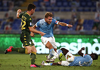 Football, Serie A: S.S. Lazio - Brescia, Olympic stadium, Rome, July 29, 2020. <br /> Lazio's  Ciro Immobile (c) in action with his teammate Habeeb Adekanye (r) and Brescia's Andrea Papetti (l) during the Italian Serie A football match between S.S. Lazio and Brescia at Rome's Olympic stadium, Rome, on July 29, 2020. <br /> UPDATE IMAGES PRESS/Isabella Bonotto