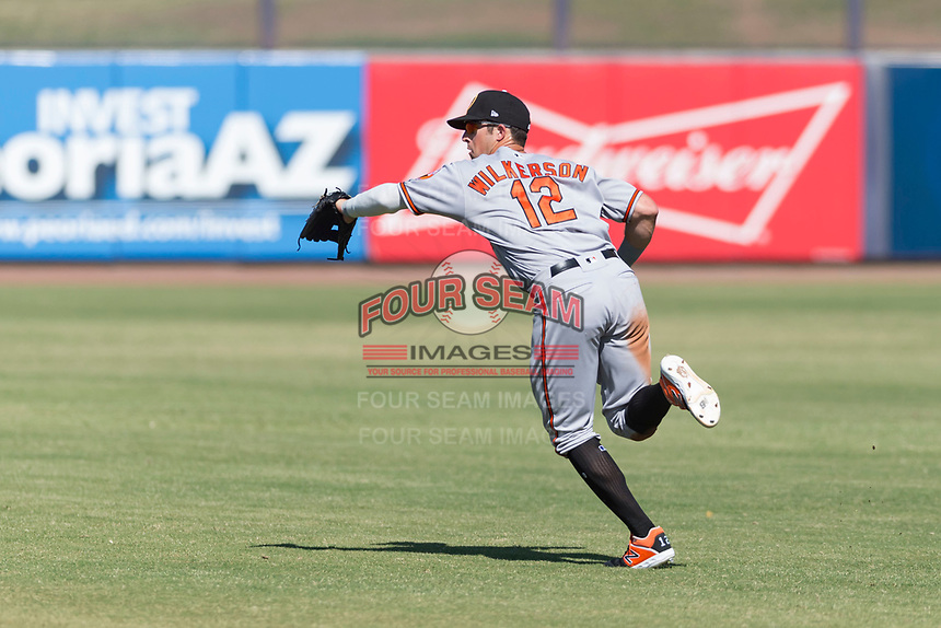 Glendale Desert Dogs second baseman Steve Wilkerson (12), of the Baltimore Orioles organization, attempts to field a ball during an Arizona Fall League game against the Peoria Javelinas at Peoria Sports Complex on October 22, 2018 in Peoria, Arizona. Glendale defeated Peoria 6-2. (Zachary Lucy/Four Seam Images)