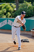 """Charleston Riverdogs pitcher Alex Mauricio (21) warming up in the bullpen before a game against the Hickory Crawdads at the Joseph P. Riley Ballpark in Charleston, South Carolina. For Sunday games, the Riverdogs wear their """"Holy City"""" uniforms in honor of the city's nickname. Hickory defeated Charleston 8-7. (Robert Gurganus/Four Seam Images)"""