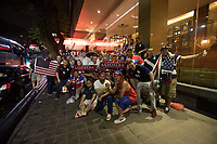 MEXICO CITY, MEXICO - June 11, 2017:  USA fans pose for a photograph at their hotel after attending the World Cup Qualifier match against Mexico at Azteca Stadium.