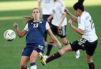 US's Alex Morgan fights for the ball with Germany's Celia Okoyino Da Mbabi during their Algarve Women's Cup soccer match at Algarve stadium in Faro, March 13, 2013.  .Paulo Cordeiro/ISI