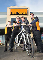 11/01/12  Stephen Roche, Store Manager (centre) at Halfords Carrickmines, Dublin and staff members, Stephen Giltrap (left) and Brendan Horan are congratulated by Area Manager, Phil Barr for being the top selling Halfords Store in the week before Christmas throughout the whole of Ireland and the UK. .They sold one bike every eight minutes  during store hours. The staff and manager were congratulated by Phil Barr, and were rewarded with a team evening out paid for by Halfords....Picture Colin Keegan, Collins, Dublin.