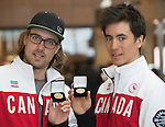 Montreal, Que. - March 28, 2014 - Graham Nishikawa and Robin Femy receive their limited edition gold-plated coins at the CIBC Paralympic Welcome Home event in Montreal on March 28, 2014.