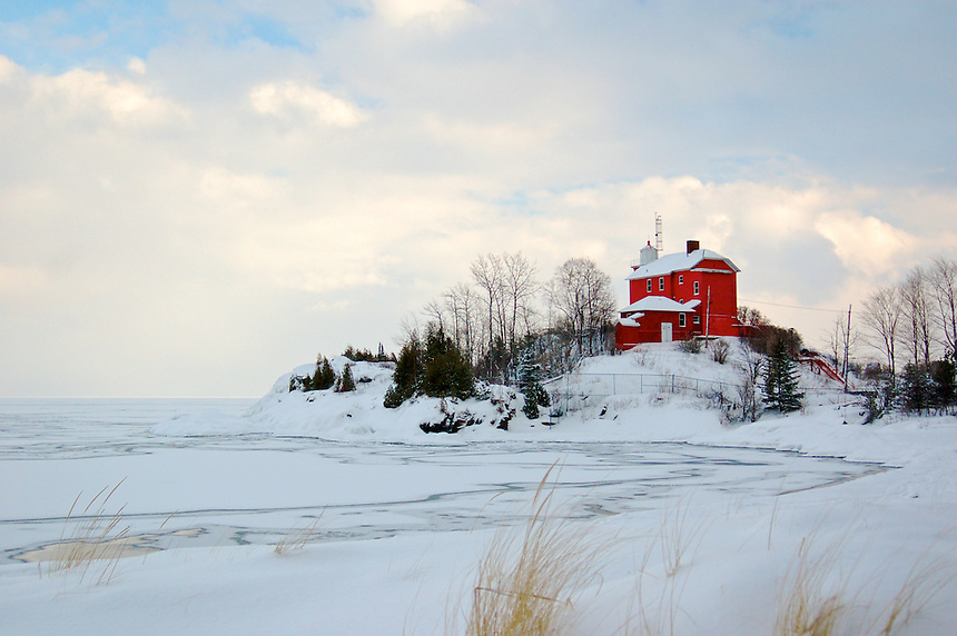 The colorful Marquette Lighthouse on a cold winter day. Marquette, MI