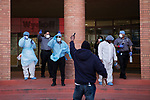 Healthcare workers watch as firefighter honor them in front of the Wyckoff Heights Medical Center during the coronavirus pandemic (COVID-19) in the Brooklyn borough of New York City on April 5, 2020.  Photograph by Michael Nagle
