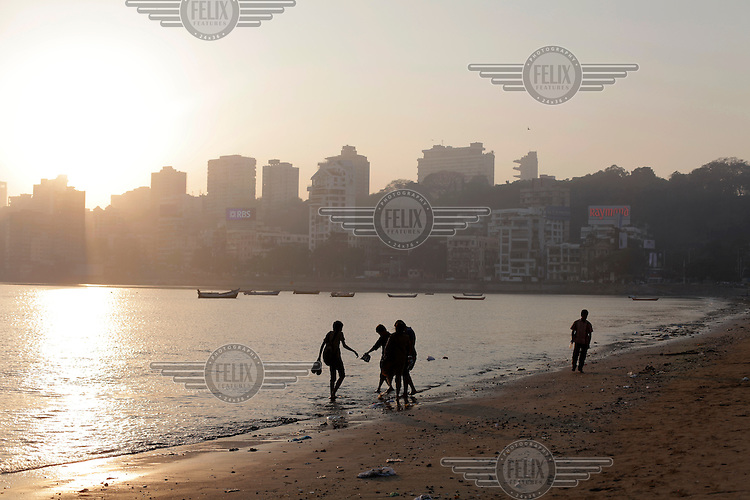Sunset at Chowpatty beach in central Mumbai, with the skyline of Malabar Hill in the background.