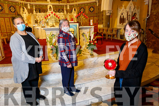 Juliette Culloty holding the relic of Padre Pio at the evening devotion to Padre Pio in the Church of Saints Stephen and St John in Castleisland on Tuesday. Front right: Juliette Culloty Back: Nora Fealy and Noreen O'Sullivan.