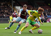 2nd October 2021;  Turf Moor, Burnley, Lancashire, England; Premier League football, Burnley versus Norwich City: Josh Sargeant of Norwich City shields the ball from Nathan Collins of Burnley