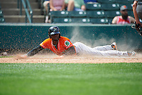 Norfolk Tides right fielder Xavier Avery (15) slides home during a game against the Rochester Red Wings on July 17, 2016 at Frontier Field in Rochester, New York.  Rochester defeated Norfolk 3-2.  (Mike Janes/Four Seam Images)