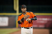 Beicker Mendoza (12) of the AZL Giants jogs to the dugout between innings of a game against the AZL Cubs on September 5, 2017 at Scottsdale Stadium in Scottsdale, Arizona. AZL Cubs defeated the AZL Giants 10-4 to take a 1-0 lead in the Arizona League Championship Series. (Zachary Lucy/Four Seam Images)
