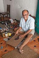 Stone Town, Zanzibar, Tanzania.  Hindu Shoemaker from Gujarat, born in Zanzibar.