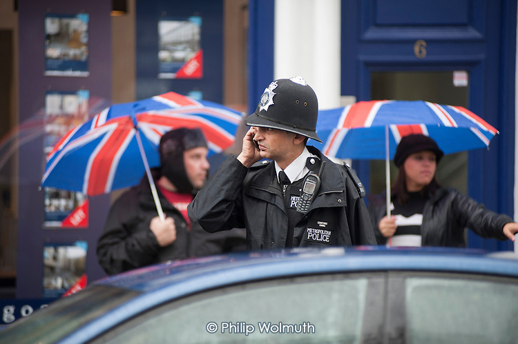 Metropolitan Police Constable with Community Support Officers, Paddington.