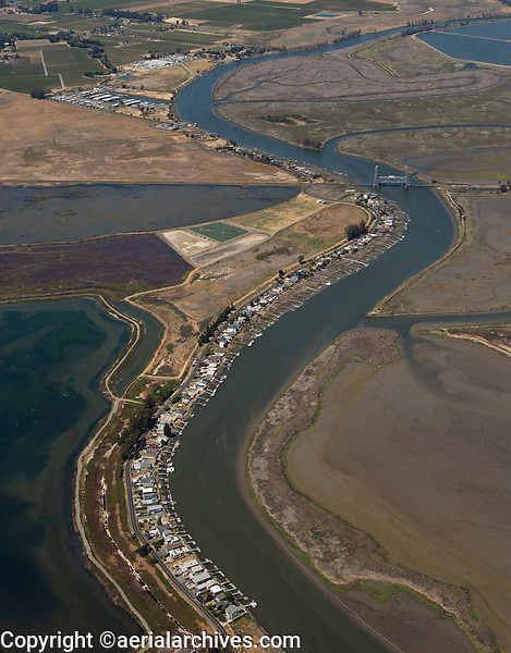 aerial photograph of the Napa River, Napa County, California from Salt Point Park and Isla Cabo Park, Brazos Drawbridge and the Napa Valley Marina in the background