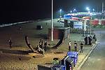 © Joel Goodman - 07973 332324. 26/09/2017. Brighton, UK. People stand around monuments amongst the shingles of Brighton beach . Revellers at the end of a night out in Brighton during Freshers week , when university students traditionally enjoy the bars and clubs during their first nights out in a new city . Photo credit : Joel Goodman