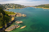 BNPS.co.uk (01202 558833)<br /> Pic: Savills/BNPS<br /> <br /> The mouth to Salcombe Estuary counts dolphins and basking sharks among its regular visitors. <br /> <br /> A breathtaking clifftop home that comes with its own private beach has emerged for sale for an incredible £2m.<br /> <br /> Bar Lodge, which dates back to the Edwardian period, sits in a stunning coastal position right in the mouth of the Salcombe Estuary in Devon.<br /> <br /> It is positioned high above the sea and enjoys unrivaled views right across the picturesque waterway and rocky coastline.