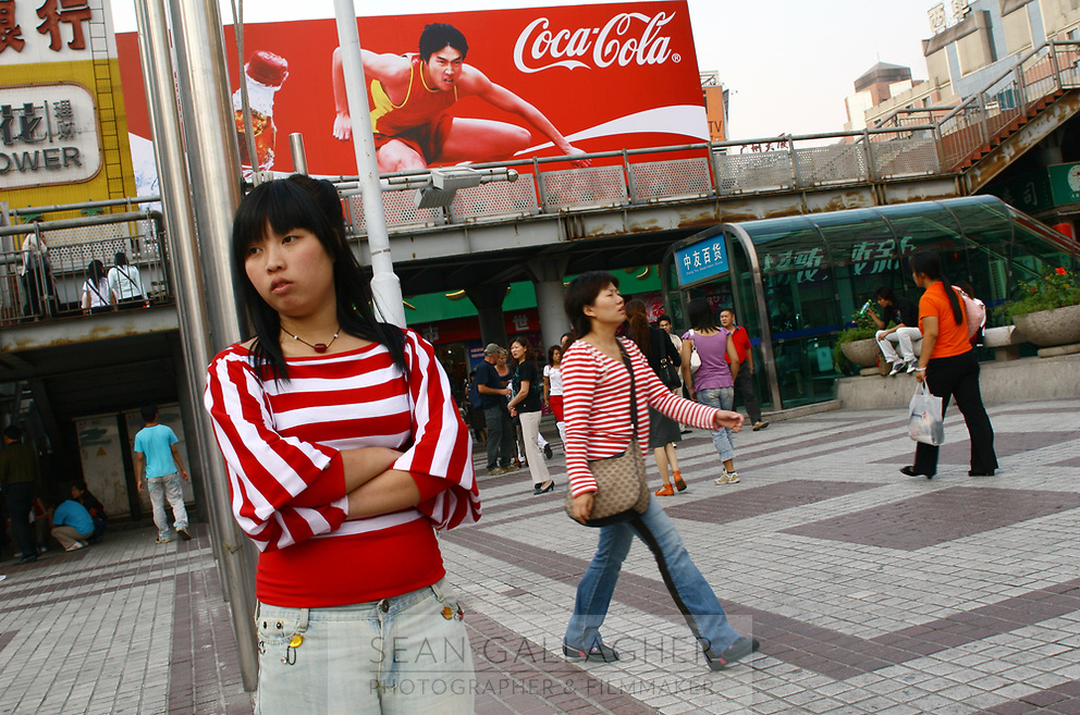 CHINA. Beijing. Shoppers in the Xidan shopping district in central Beijing. 2006.