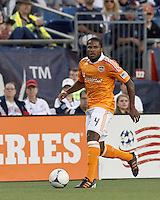 Houston Dynamo defender Jermaine Taylor (4) looks to pass. In a Major League Soccer (MLS) match, the New England Revolution tied Houston Dynamo, 2-2, at Gillette Stadium on May 19, 2012.