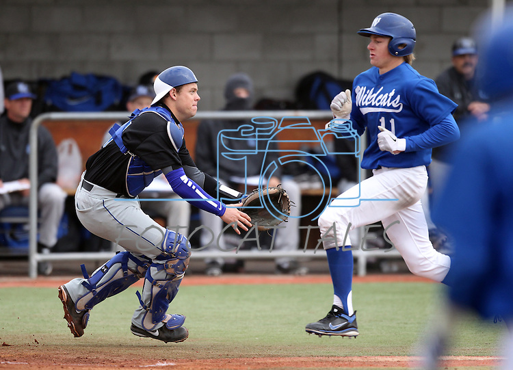 Wildcats' Conor Harber scores past catcher TC Mark in the first game of a doubleheader against South Mountain Community College, at WNC in Carson City, Nev., on Friday, Jan. 25, 2013. WNC won the first game 5-1..Photo by Cathleen Allison
