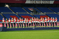 YOKOHAMA, JAPAN - AUGUST 6: Team Canada during the national anthem after winning the gold medal after a game between Canada and Sweden at International Stadium Yokohama on August 6, 2021 in Yokohama, Japan.