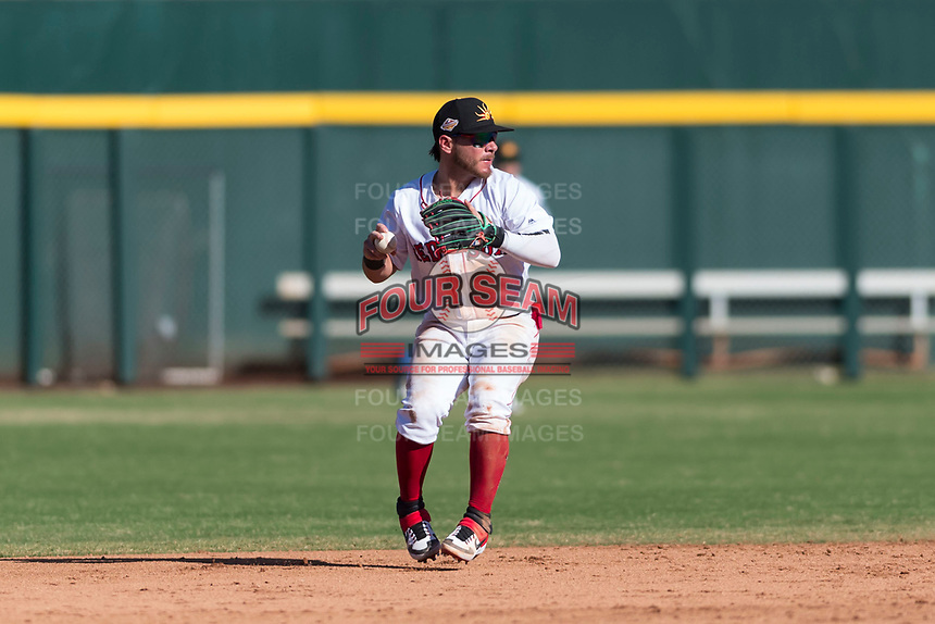 Mesa Solar Sox second baseman Esteban Quiroz (2), of the Boston Red Sox organization, prepares to make a throw to first base during an Arizona Fall League game against the Salt River Rafters at Sloan Park on October 30, 2018 in Mesa, Arizona. Salt River defeated Mesa 14-4 . (Zachary Lucy/Four Seam Images)