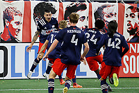20th November 2020; Foxborough, MA, USA;  Teammates rush in after the stoppage time winner from New England Revolution forward Gustavo Bou during the MLS Cup Play-In game between the New England Revolution and the Montreal Impact