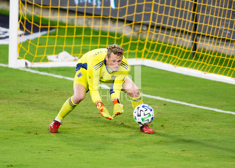 LOS ANGELES, CA - SEPTEMBER 23: Bryan Meredith #1 GK of the Vancouver Whitecaps make a save during a game between Vancouver Whitecaps and Los Angeles FC at Banc of California Stadium on September 23, 2020 in Los Angeles, California.