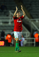 Saturday 17 November 2012<br /> Pictured L-R: Ben Davies of Swansea thanks away supporters after the final whistle.<br /> Re: Barclay's Premier League, Newcastle United v Swansea City FC at St James' Park, Newcastle Upon Tyne, UK.