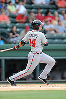 Left fielder Joey Meneses (34) of the Rome Braves bats in a game against the Greenville Drive on Tuesday, August 20, 2013, at Fluor Field at the West End in Greenville, South Carolina. Rome won, 4-2. (Tom Priddy/Four Seam Images)